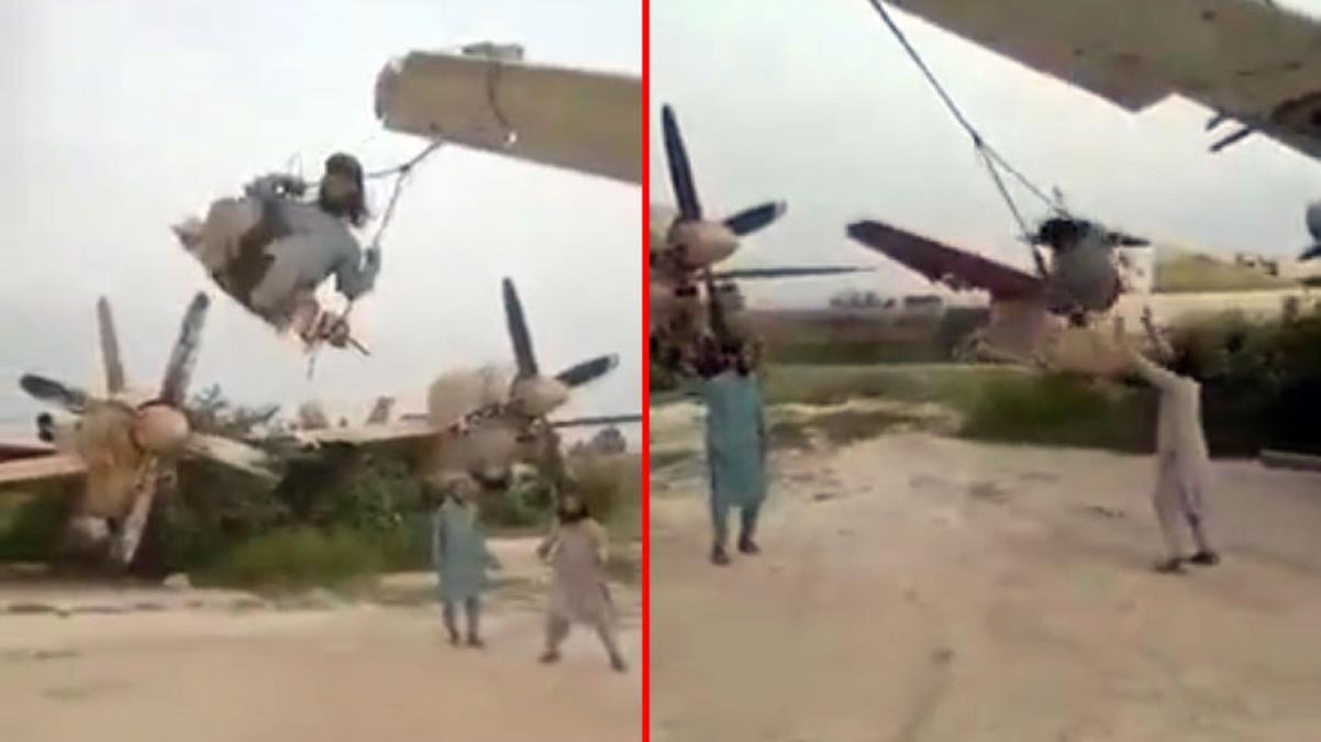 Taliban, ABD'ye ait askeri uçakların kanatlarını salıncağa çevirdi