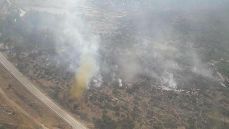 İzmir'de ormanlık alanda çıkan yangın kısa sürede kontrol altına alındı